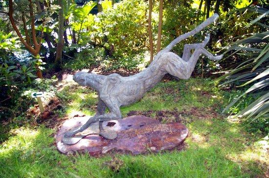 Wild Subtropical Garden: big Landing Cheetah by Jan Sweeney