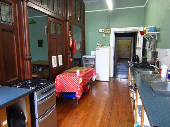 Kilkenny Tourist Hostel: The other side of the kitchen (the dining is on the other side of the wooden panels).
