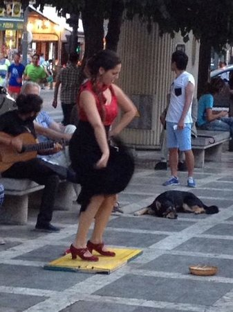 Puerta de Las Granadas: street entertainment in square