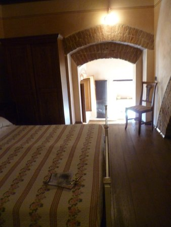 "Osteria del Borgo: view to second room of ""suite"""