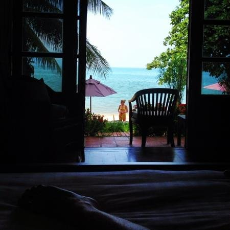 The Lodge : laying bed over looking my private balcony leading onto the beach