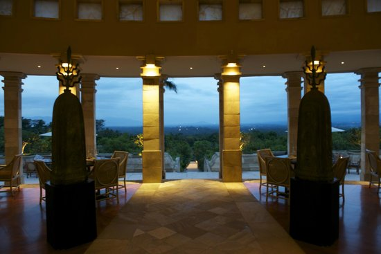 Amanjiwo Resorts: evening in the main dining room -- Borobudur in the distance
