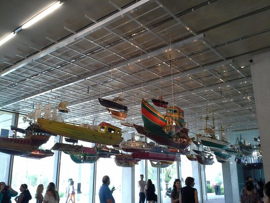 Perez Art Museum Miami: A suspended sculpture of multiple boats suspended from the main lobby ceiling
