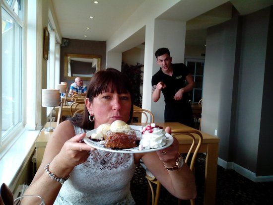 North Ocean Hotel: sticky toffee pudding with Chris in back ground