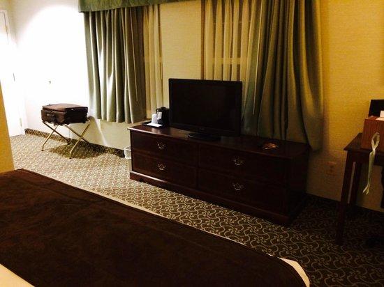 D. Hotel & Suites: TV opposite bed