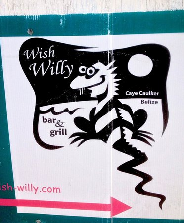 Wish Willy - Bar & Grill : Sign directing to Wish Willy from the front street