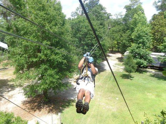 Adventures Unlimited Outdoor Center: Hubby Zipping Thru