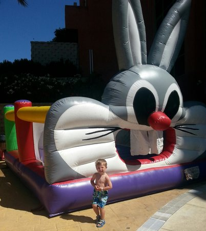 Holiday Palace: bouncy castle put up at pool one day for kids