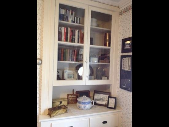 """Lizzie Borden House: Title of one Lizzie's actual books on this shelf: """"With Edged Tools"""""""