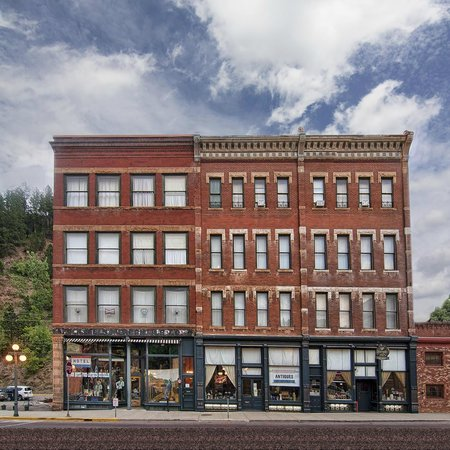 Deadwood Dick's Hotel with beautiful blue sky and clouds