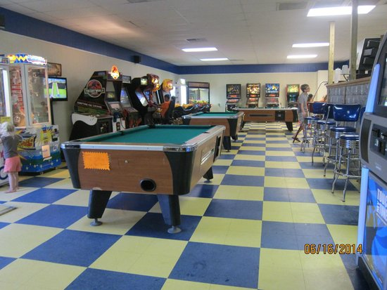Angelo's Pizza : arcade and game room with additional seating