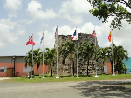 Cruzan Rum Distillery: Outside of Cruzan are the seven flags which have flown over St. Croix