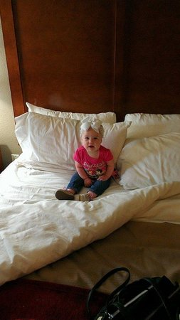 Comfort Inn & Suites at Dollywood Lane : My baby sitting on there big comfortable bed in our room