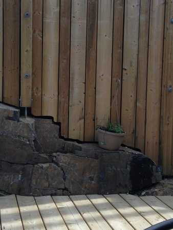 Detailed work along the edge of the outdoor patio, Nature's Inn Kenora  |  1505 Erie Street, Kee