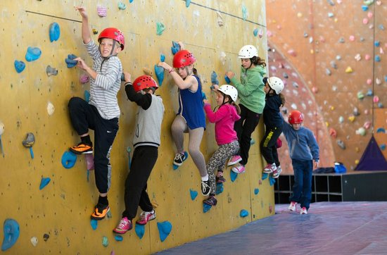 Calshot Activity Centre: One of our residential school groups enjoying the bouldering wall