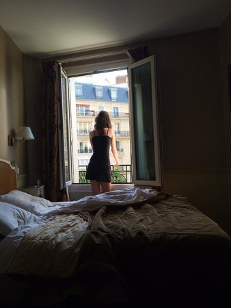 Hotel Riviera Elysees: Our daughter looking out on street.