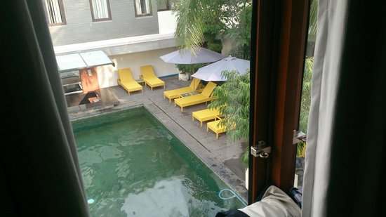 Casa Padma Hotel & Suites: View of pool from room, pool clean has greenish tiles so looks a little different