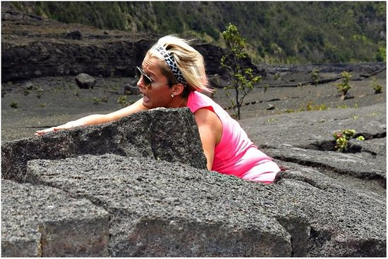 Kilauea Iki Trail: My daughter climbing out of one of the cracks in the rocks!