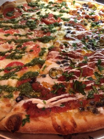 Pies & Pints: Left half pesto pie and right half the black bean pie rated West Virginias #1 Pizza