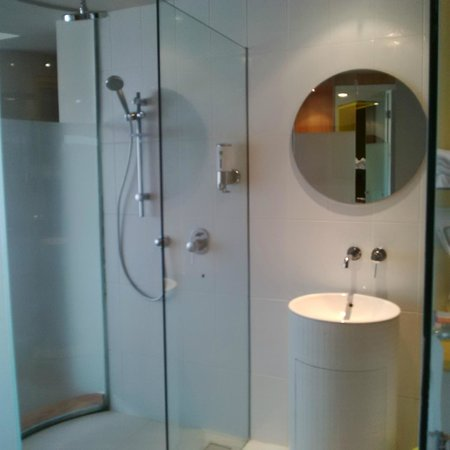 Ibis Styles Bandung Braga  Bathroom complete with 2 shower choice. Bathroom complete with 2 shower choice   Picture of Ibis Styles
