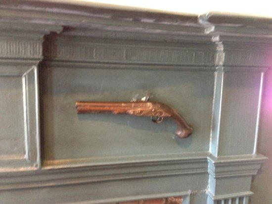 The Golden Lamb Restaurant: Revolver on the mantel