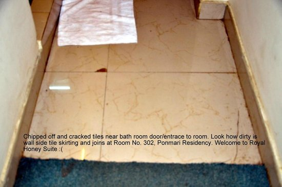 Ponmari Residencyy: Chipped off tiles and dirty entrance