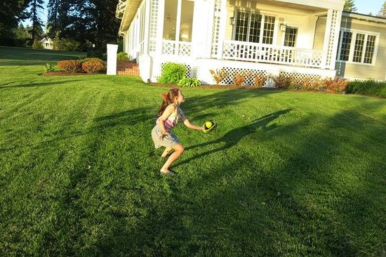 Lakeside Bed and Breakfast: Playing catch with her grandfather.