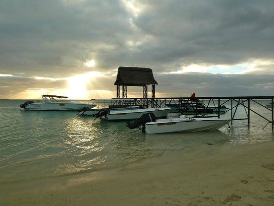 Trou aux Biches Beachcomber Golf Resort & Spa: Sunset and boat house
