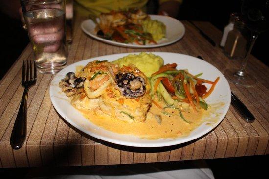 Flamingo Beach Resort & Spa: This was the amazing seafood dish that Chef Leonardo made for us! So good. SO GOOD!