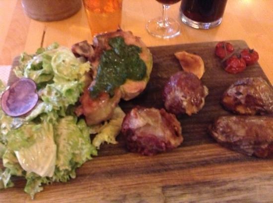 Le Goret : Pork chop with basil, sausage amd some other ball of pork.  Accompanied by potatoe halves, roast