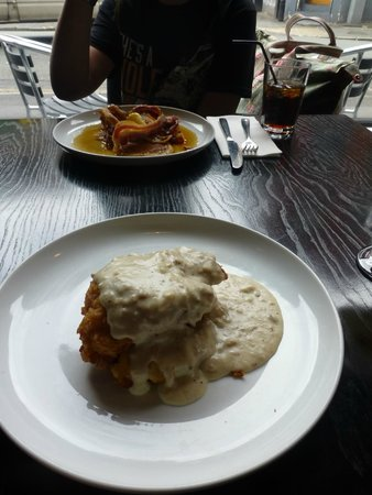 SoLita Manchester: bacon and maple pancakes + chicken and sausage gravy waffles