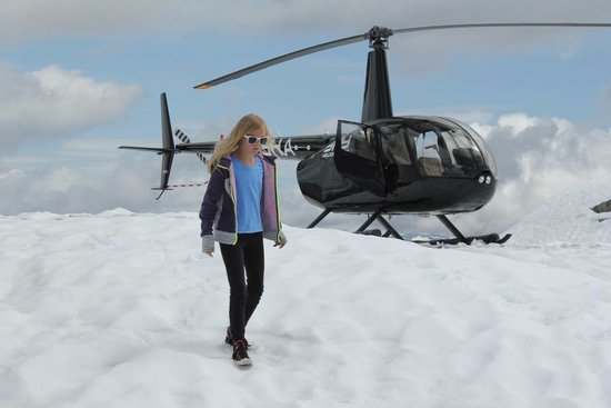 SKY Helicopters Inc.: My daughter and our Sky Helicopter atop the alpine peak.