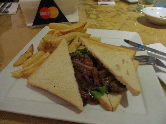 La Encantada : lomo saltado sandwich