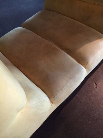 NYLO Plano at Legacy : Chair in the lobby is dirty and ripped.