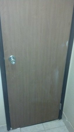 Days Inn Columbus Fairgrounds: Joint compound or ? smears on back of bath door