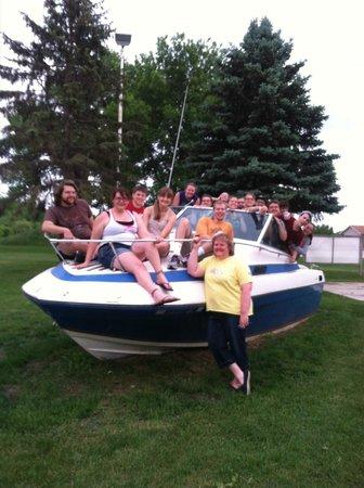 Family having fun on the boat at Ranch Okoboji