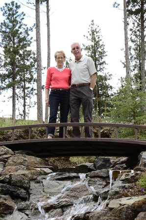 Summer Creek Inn & Spa: Doug and I standing on the bridge on top of the back waterfall