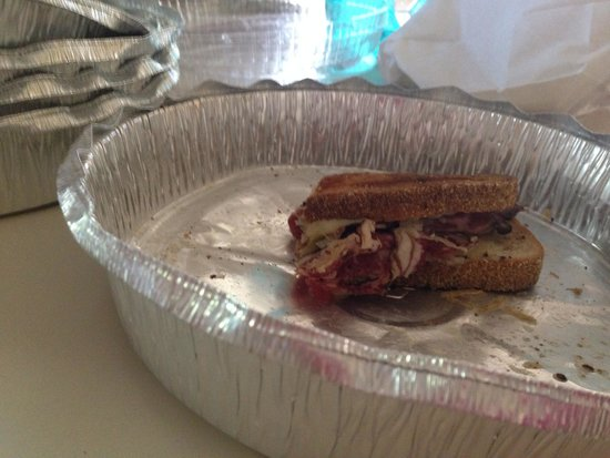 Carnegie Deli: This is 1/4 of one of the sandwiches just as i got it- nothing like what you see when you google