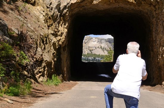 Iron Mountain Road : A shot of my husband shooting Mount Rushmore through the tunnel