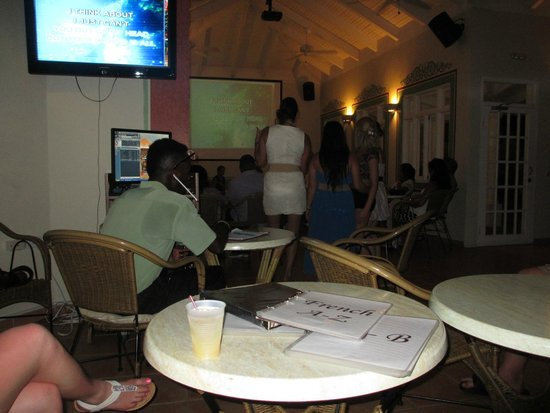 Grand Bahia Principe Jamaica: Karaoke bar. Yes, the worker has straws in his ears to block out the horrible singing LOL