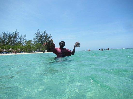 Grand Bahia Principe Jamaica: A vendor in the water.