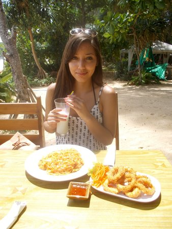 Naithonburi Beach Resort: One of the restaurants along the road - delicious food