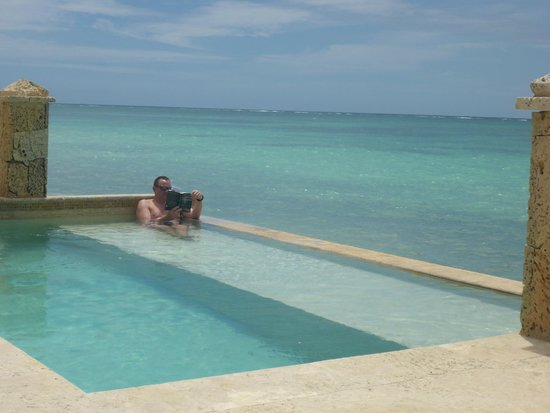 Sanctuary Cap Cana by AlSol: relaxing in our villa pool