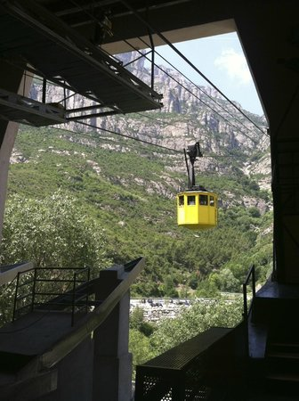 Barcelona Turisme - Afternoon in Montserrat Tour: You take the yellow finicular up to the top to begin your hike.