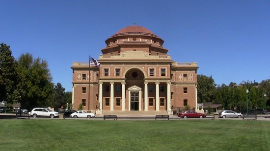 The Atascadero Administration Building is the backdrop for the Sunken Gardens