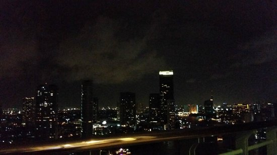 Chao Phraya River: Nighttime View Across River from Chatrium Hotel Riverside