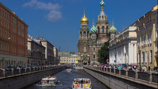 DenRus Complete St Petersburg tour approaching Church on Spilled Blood by canal boat