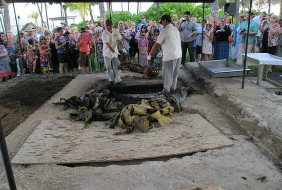 Island Breeze Luau: Of true Luau tradition, pulling the pig from the buried coals