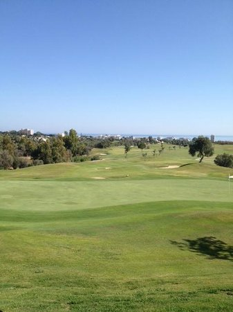 Marbella Golf & Country Club: From the bar (cold beer in hand) looking back over 18th green