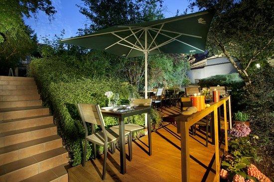 Santini Garden: Outdoor seating area in the garden